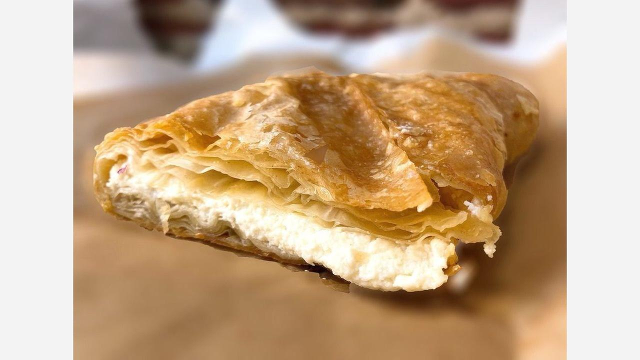 Greek breakfast pastry with feta in phyllo dough. | Photo: Cherylynn N./Yelp