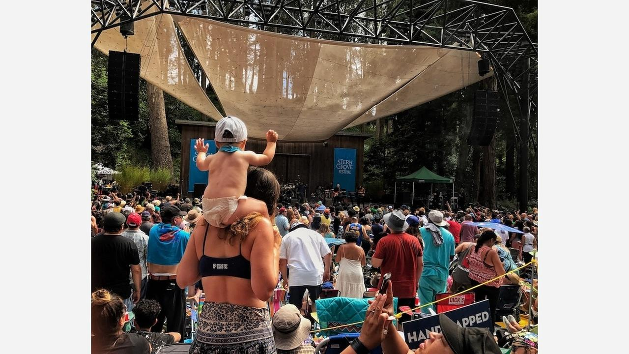 Woman with baby at Ziggy Marley concert on June 24 in Stern Grove.   Photo: Jennifer Shields/Hoodline