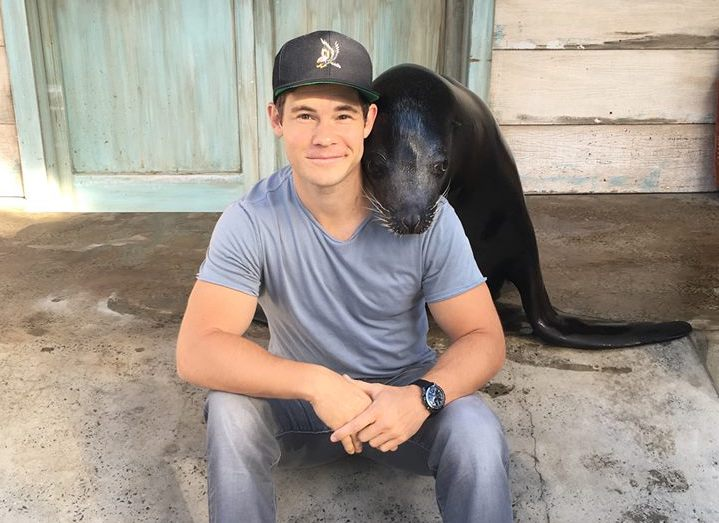 Adam Devine (pictured with a seal) will star in Lexi, filming in San Francisco this month. | Photo: Adam Devine/Facebook