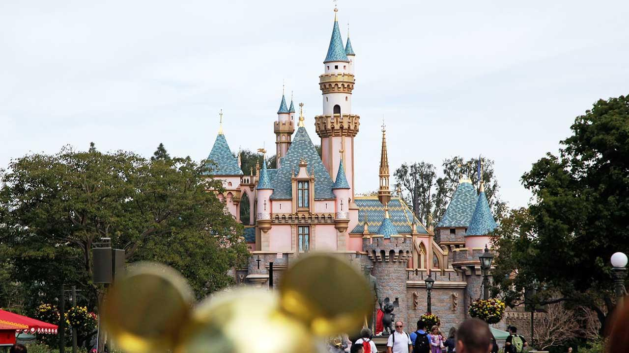 In this Jan. 22, 2015 file photo, visitors walk toward the Sleeping Beautys Castle in the background at Disneyland Resort in Anaheim, Calif.