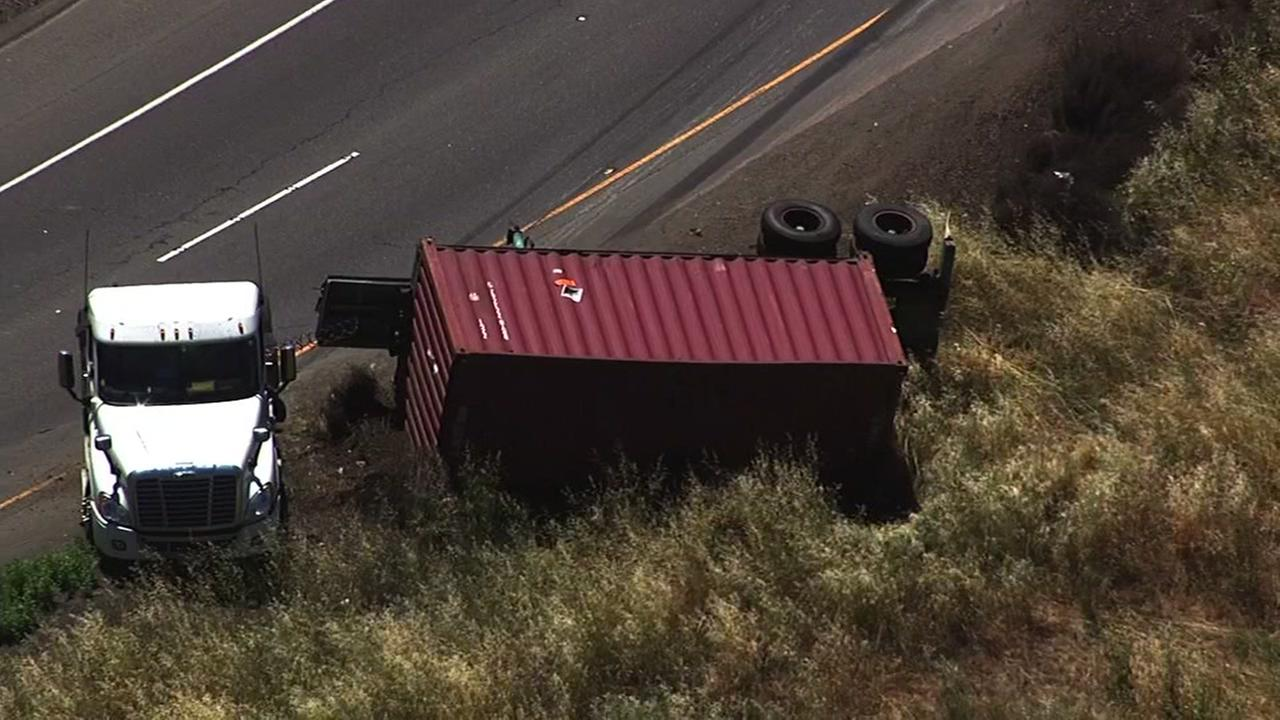 An overturned truck possibly carrying hazardous materials is seen in the San Leandro area on Wednesday, May 31, 2017.