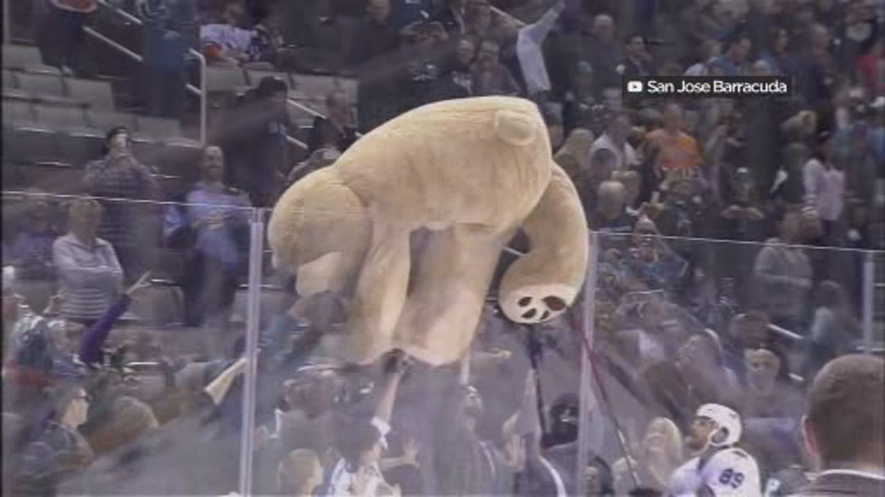 This image shows someone tossing a giant bear onto the ice during San Jose Barracuda Teddy Bear Toss in 2015.