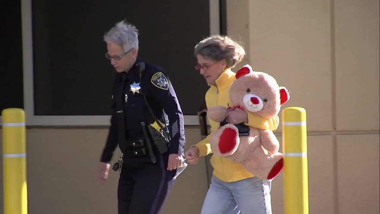 Oakland Police Chief Anne Kirkpatrick is seen on Jan. 1, 2019 carrying a teddy bear for a 6-year-old girl who was struck by celebratory gunfire on New Years Eve.