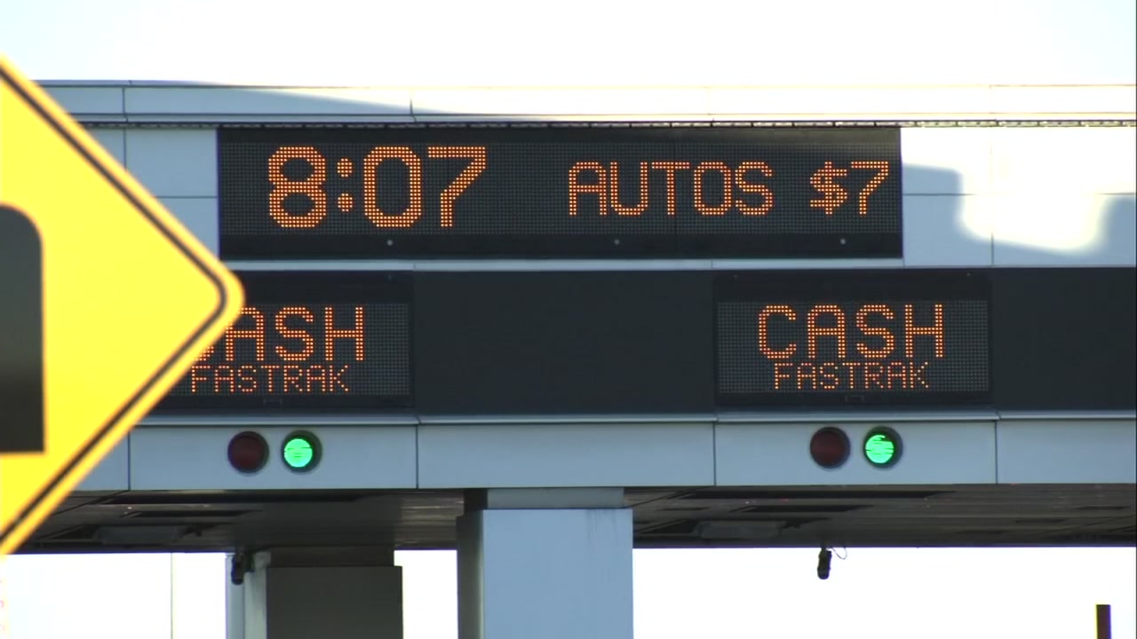 A sign displaying the cost to cross the Oakland-San Francisco Bay Bridge is seen on Jan. 2, 2019.