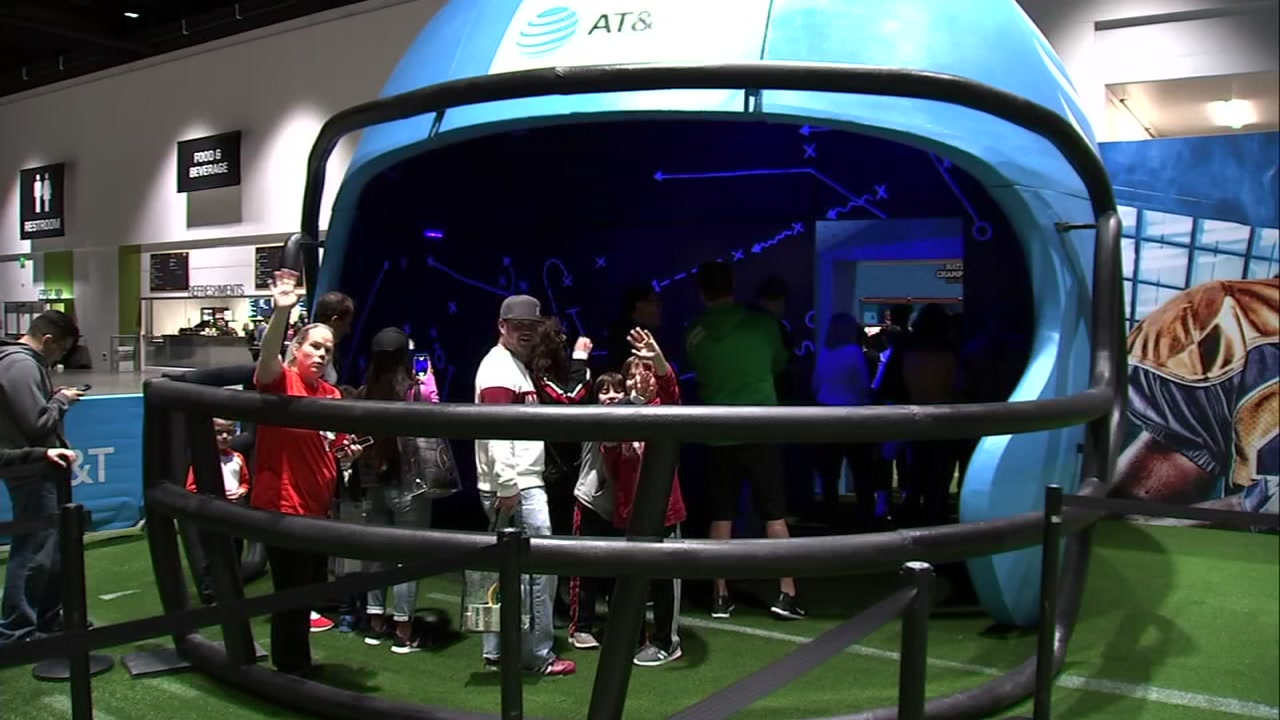 Fans are seen at the Playoff Fan Central fan experience in San Jose, Calif. on Friday, Jan. 4, 2019.