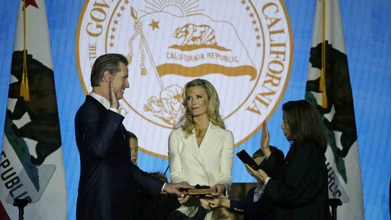 California Governor Gavin Newsom takes the oath of office from state Supreme Court Chief Justice Tani Gorre Cantil-Sakauye on Monday, Jan. 7, 2019, in Sacramento.