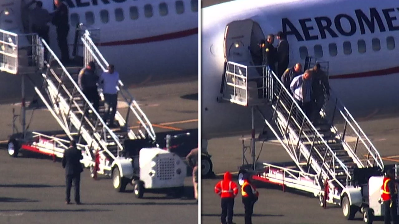 This double image shows two people being escorted of a plane at Oakland Airport in Oakland, Calif. on Thursday, Jan. 10, 2019.