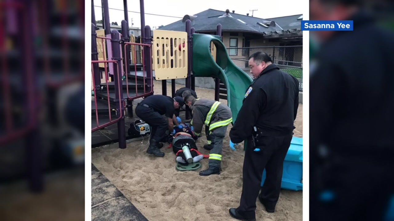 First responders are seen after a woman was brutally beaten on a playground in San Francisco on Tuesday, Jan. 8, 2019.