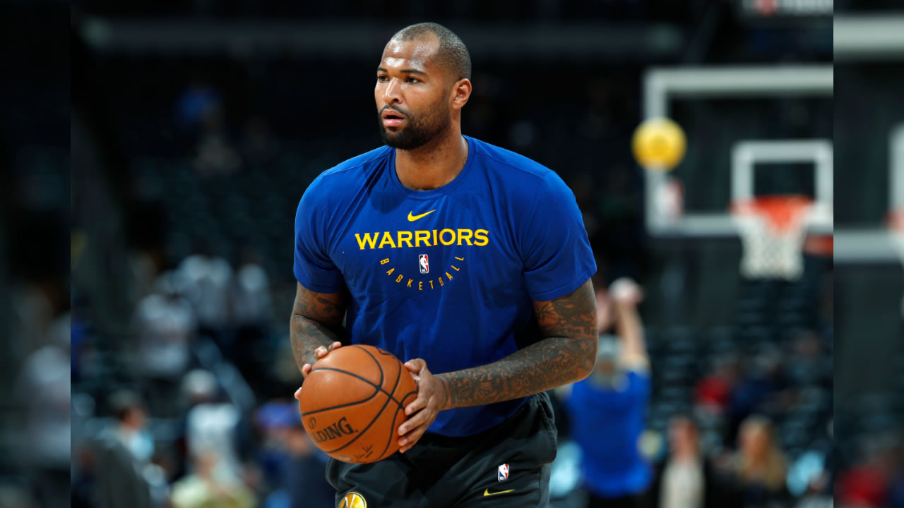 Injured Golden State Warriors center DeMarcus Cousins takes a shot as he works out before the Warriors face the Denver Nuggets in an NBA basketball game, Tuesday, Jan. 15, 2019, in Denver.