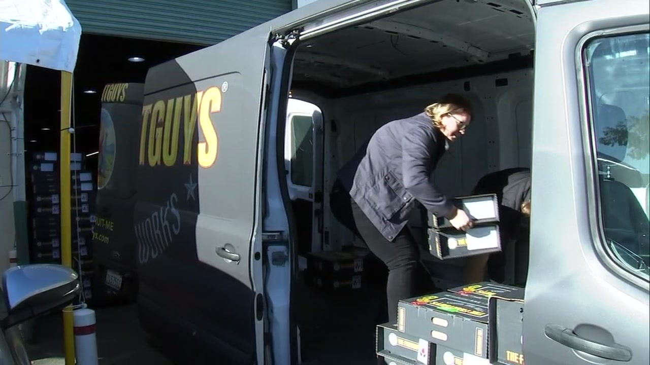 This image shows the FruitGuys company in South San Francisco, Calif. loading boxes in their truck on Wednesday, Jan. 23, 2019 to take to TSA employees affected by the government shutdown.