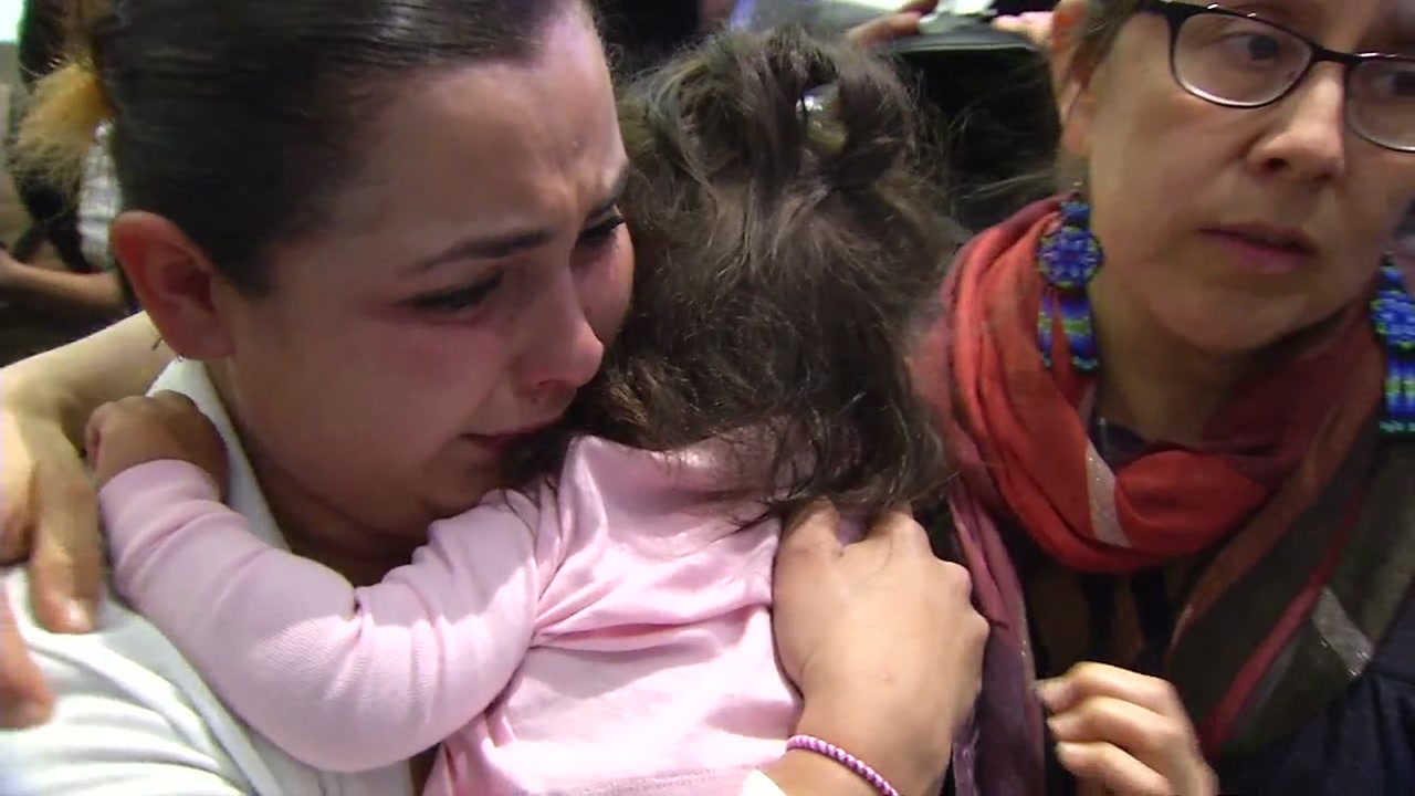 A Honduran mother is seen after being reunited with her daughter at the San Francisco International Airport on Tuesday, Jan. 29, 2019.