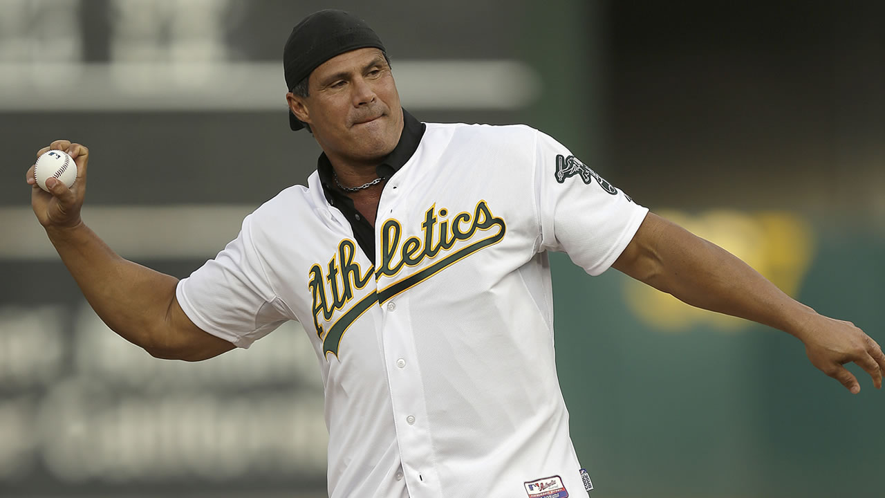 In this Sept. 3, 2016, file photo, former Oakland As player Jose Canseco throws out the first pitch prior to a baseball game against the Boston Red Sox in Oakland, Calif.