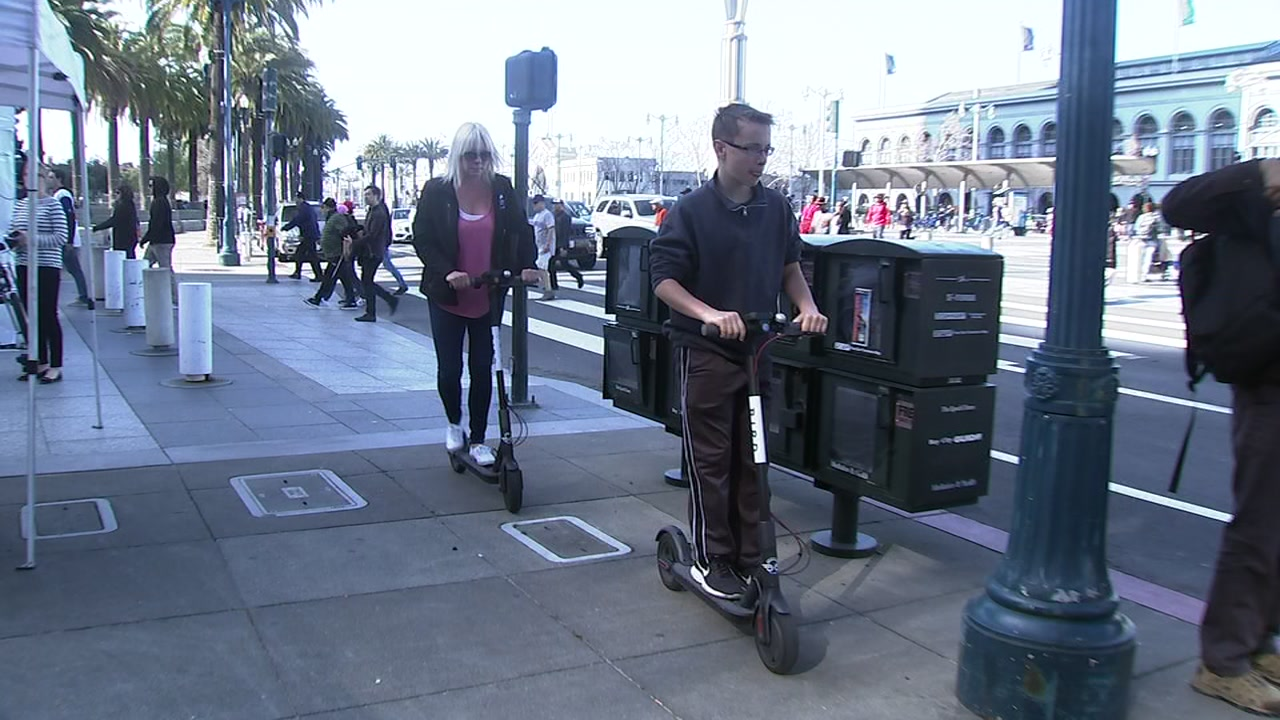 People ride electric scooters along San Franciscos Embarcadero in this undated photo.