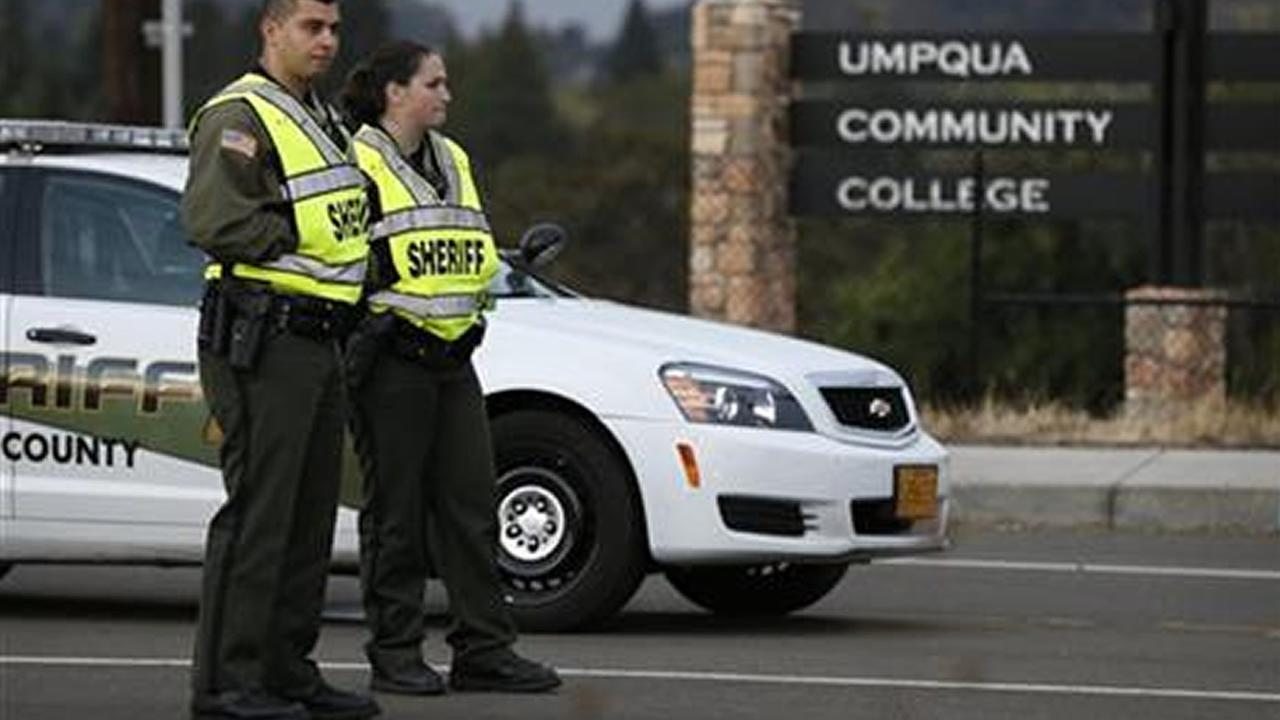 Sheriffs deputies man a roadblock on the road leading to Umpqua Community College Saturday, Oct. 3, 2015, in Roseburg, Ore.