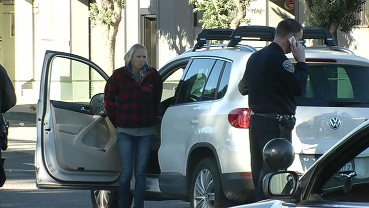 Kirsten Andereck stands by her SUV