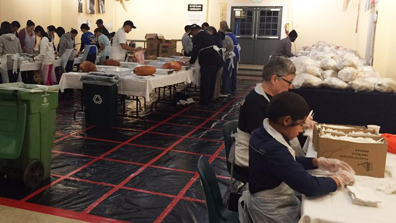 Volunteers prepare Thanksgiving meals at Glide Memorial in San Francisco, Thursday, November 26, 2015.