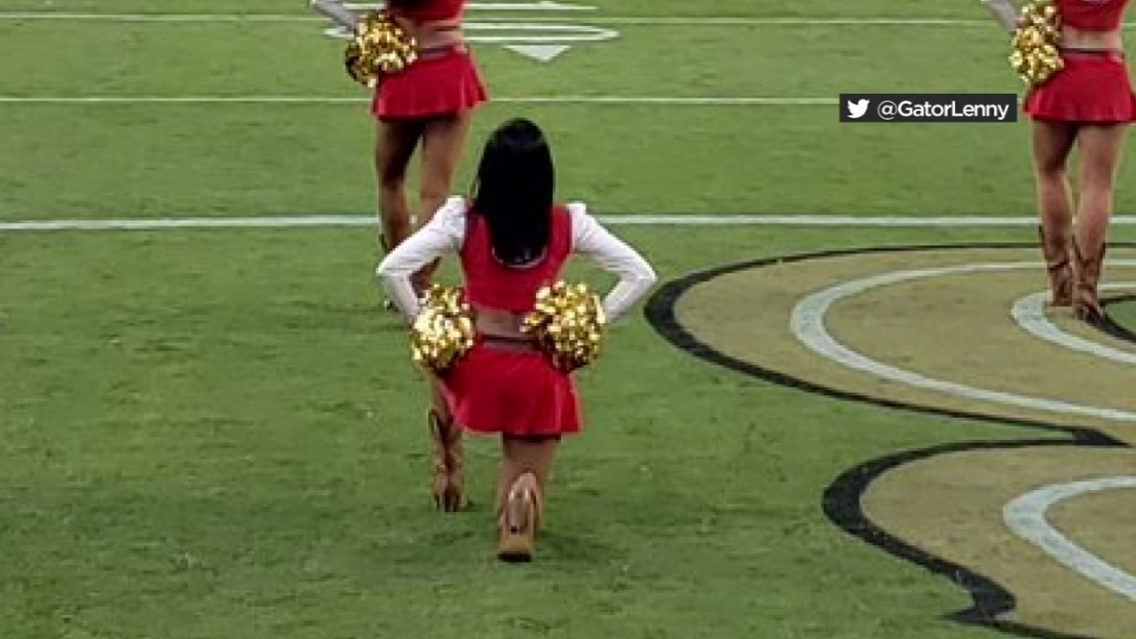 49ers cheerleader takes a knee before Raiders game