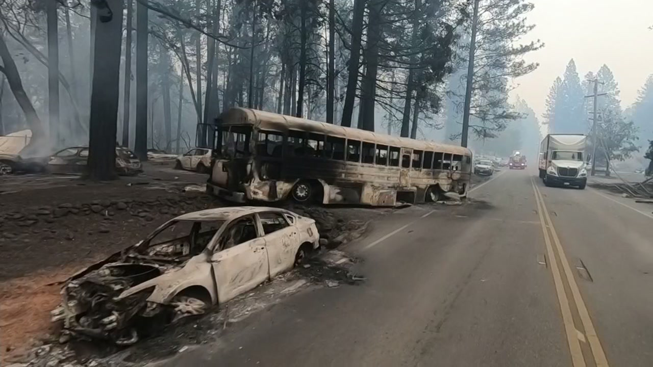 Video taken on Friday, Nov. 09, 2018 shows a road full of burned out cars in the town of Paradise, Calif.