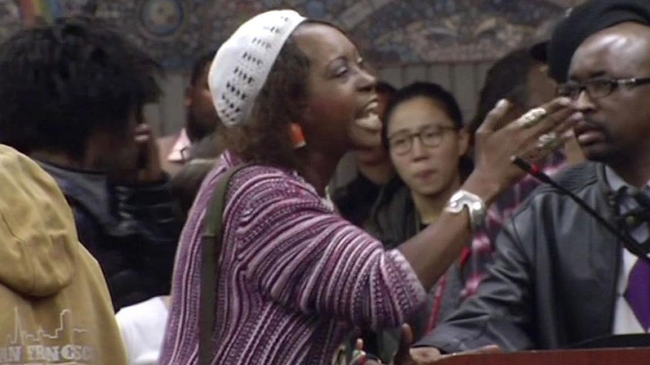 woman shouts at town hall meeting