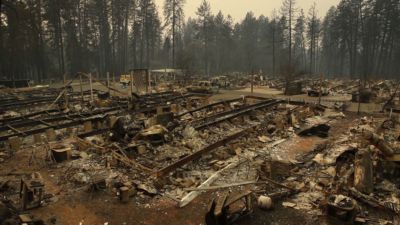 Rubble remains where mobile homes once stood at the Camp Fire, Monday, Nov. 12, 2018, in Paradise, Calif.