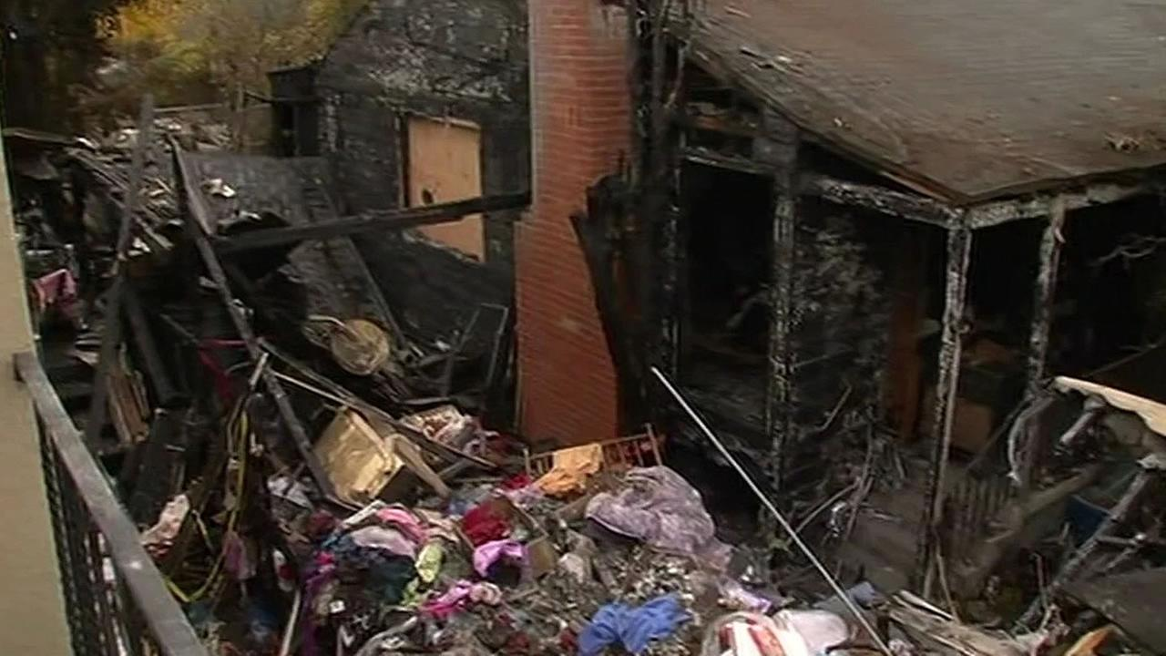 A fire that broke out at an RV trailer spread to a nearby home and left a family displaced on Clara Street in East Oakland, Calif. on Wednesday, December 9, 2015.
