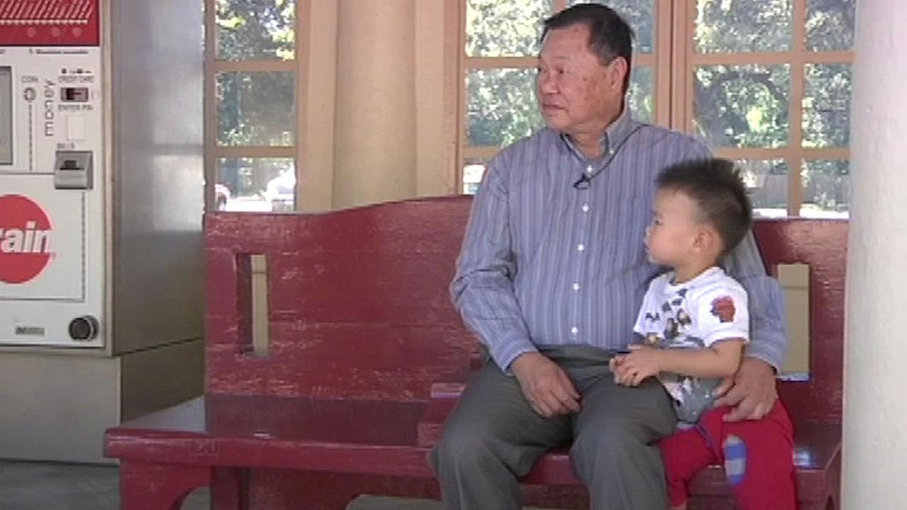 David Chu of Atherton waits for a Caltrain with his young grandson