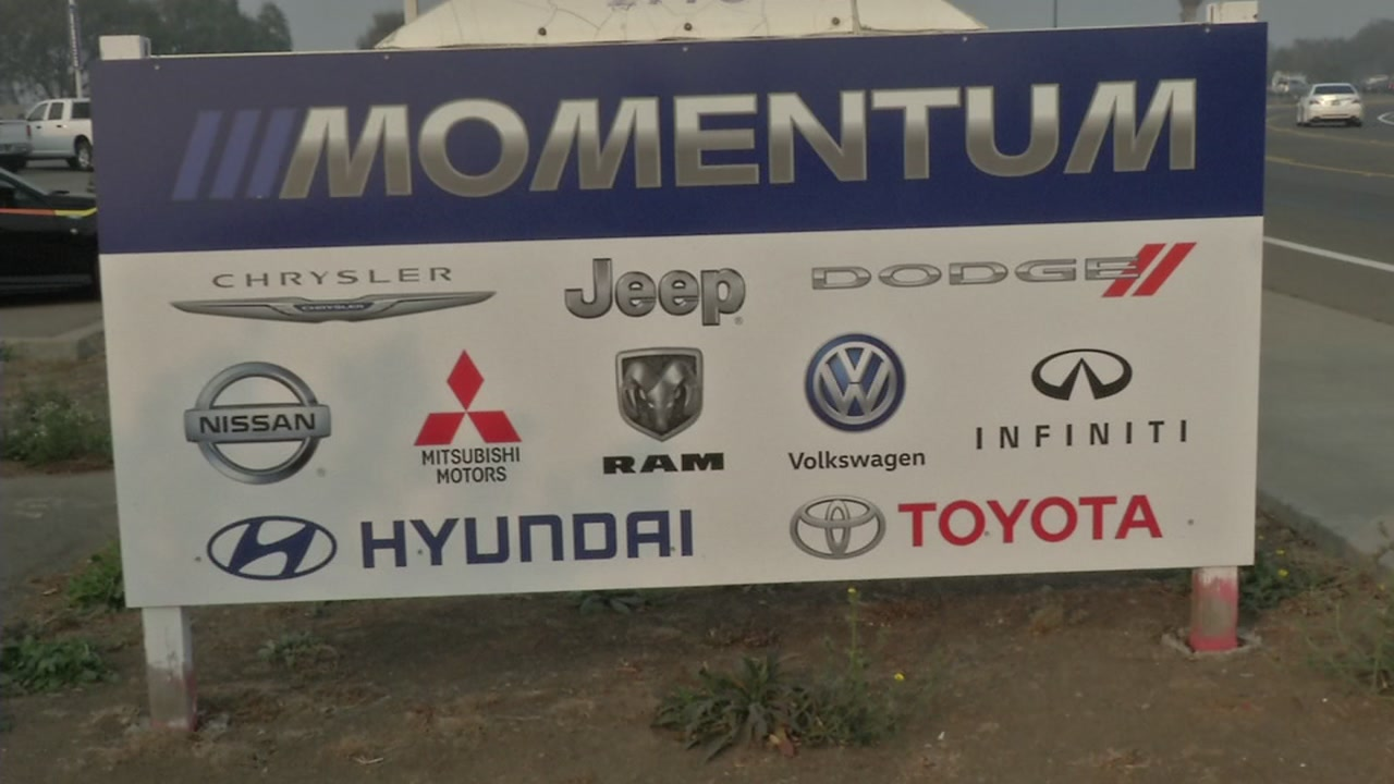A sign for the Momentum Auto Dealer group is seen in this undated image.