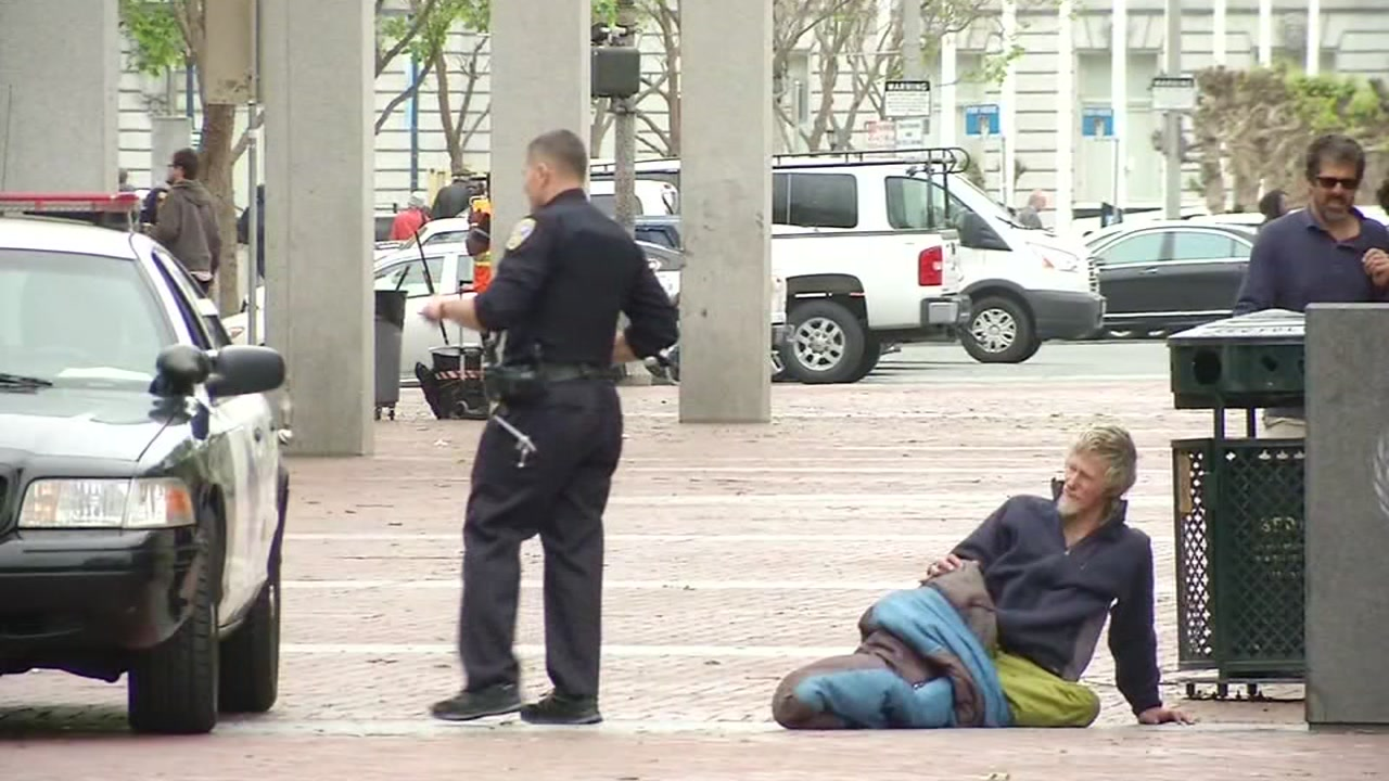 A San Francisco police officer is seen near a homeless person in this undated image.