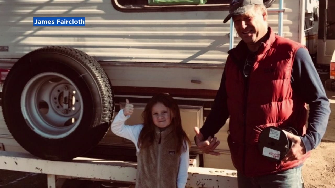 James Faircloth and his six-year-old daughter are seen next to an RV they are donating to Camp Fire victims in this undated image.