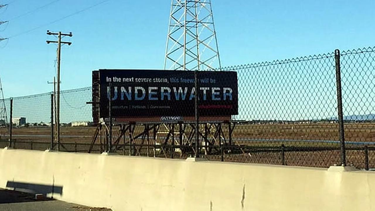 A billboard along Highway 101 in Silicon Valley, Calif. reads: In the next severe storm, this freeway will be underwater in this undated image.