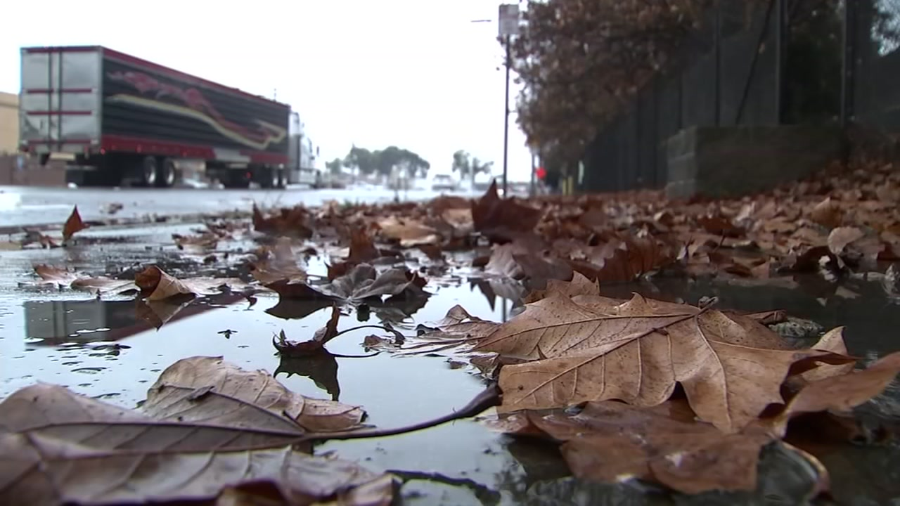 This photo shows water puddling in the street in San Jose, Calif. on Wednesday, Nov. 28, 2018.