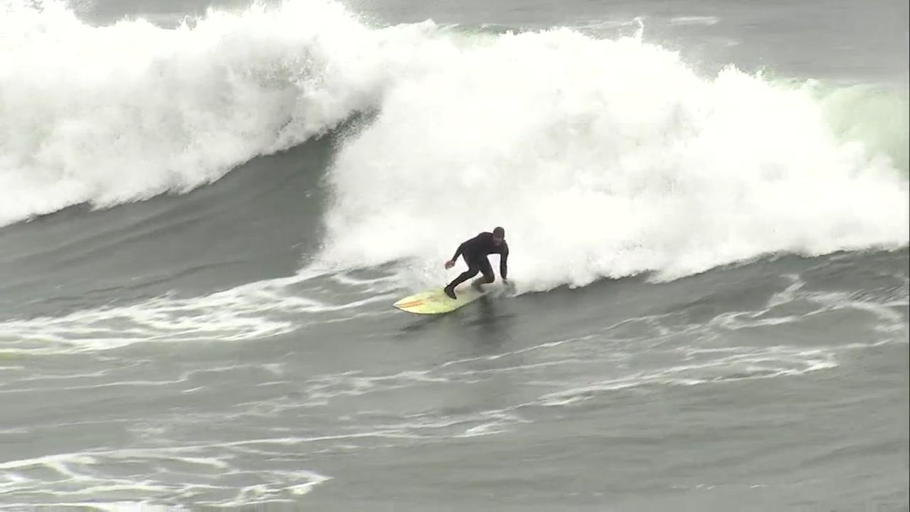 A surfer is seen at Steamer Lane in Santa Cruz, Calif. on Wednesday, Nov. 28, 2018.