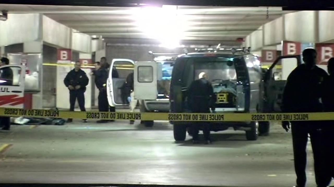 Hayward police officers investigate after a boy was found in a U-Haul at a parking structure at a Hayward, Calif. BART station Dec. 25, 2015.