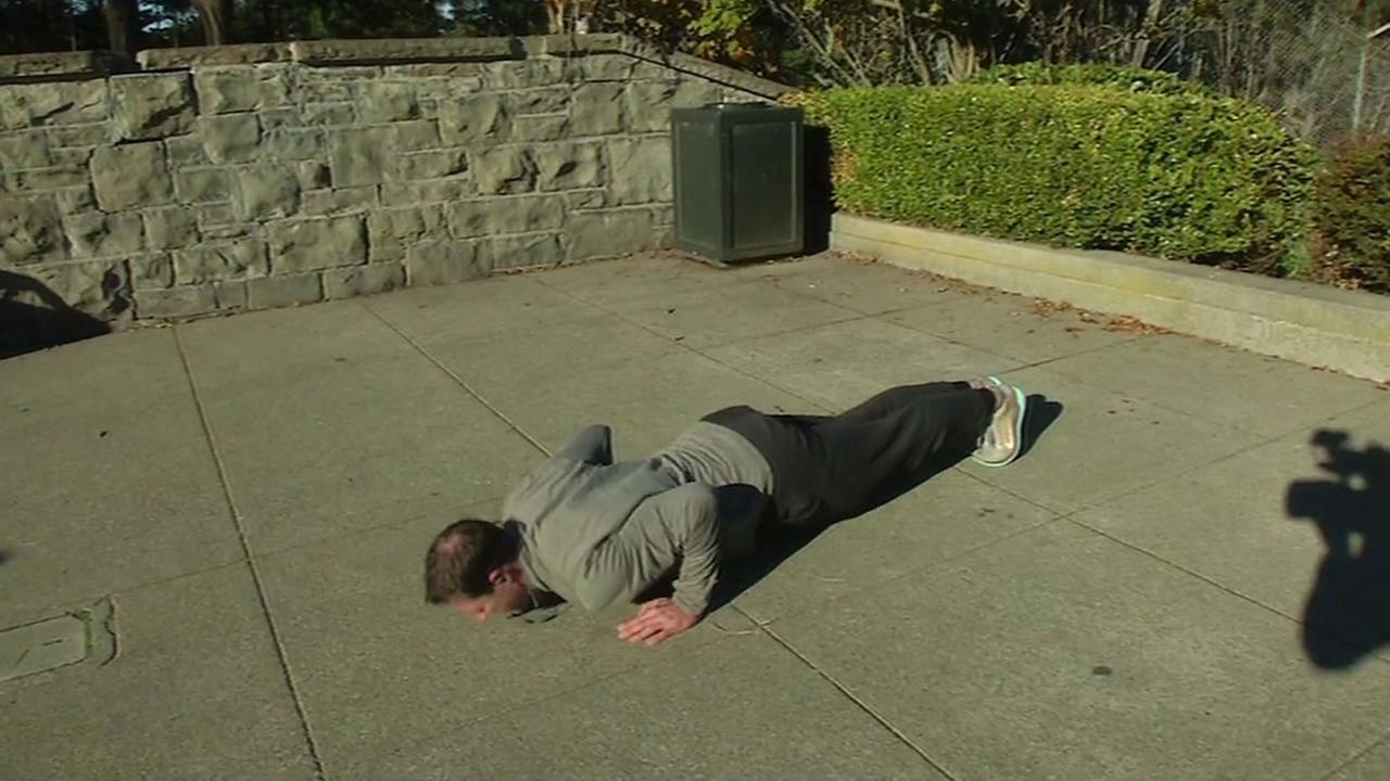 A San Francisco man exercises on Friday, January 1, 2016.