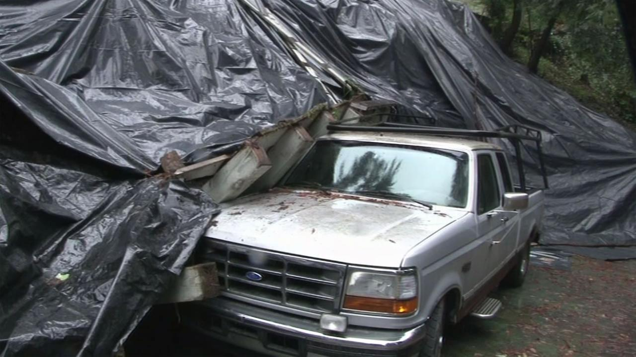 First of several El Nino storms caused a fence to collapse on a truck in Petaluma, Calif. on Monday, January 4, 2016.