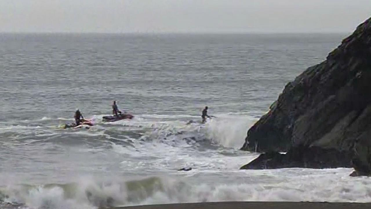 3 rescuers on jet skis search for missing surfer