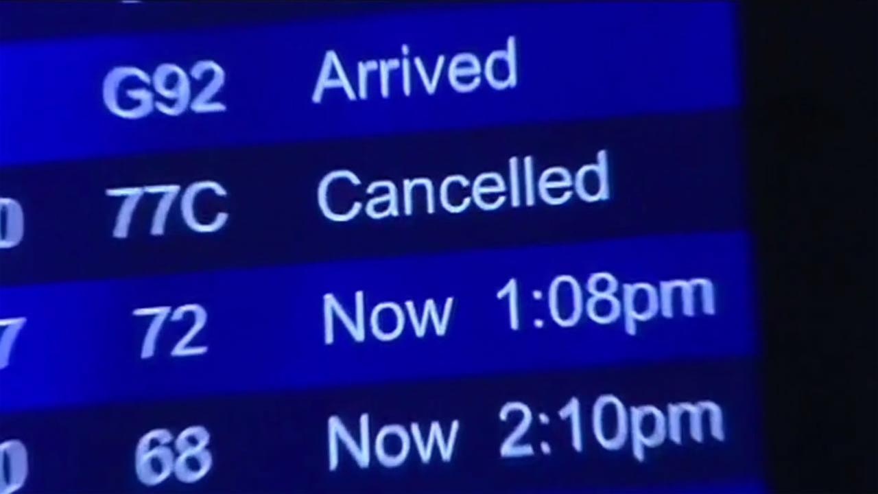 Flight board showing canceled flights at the San Francisco International Airport Jan. 22, 2016.