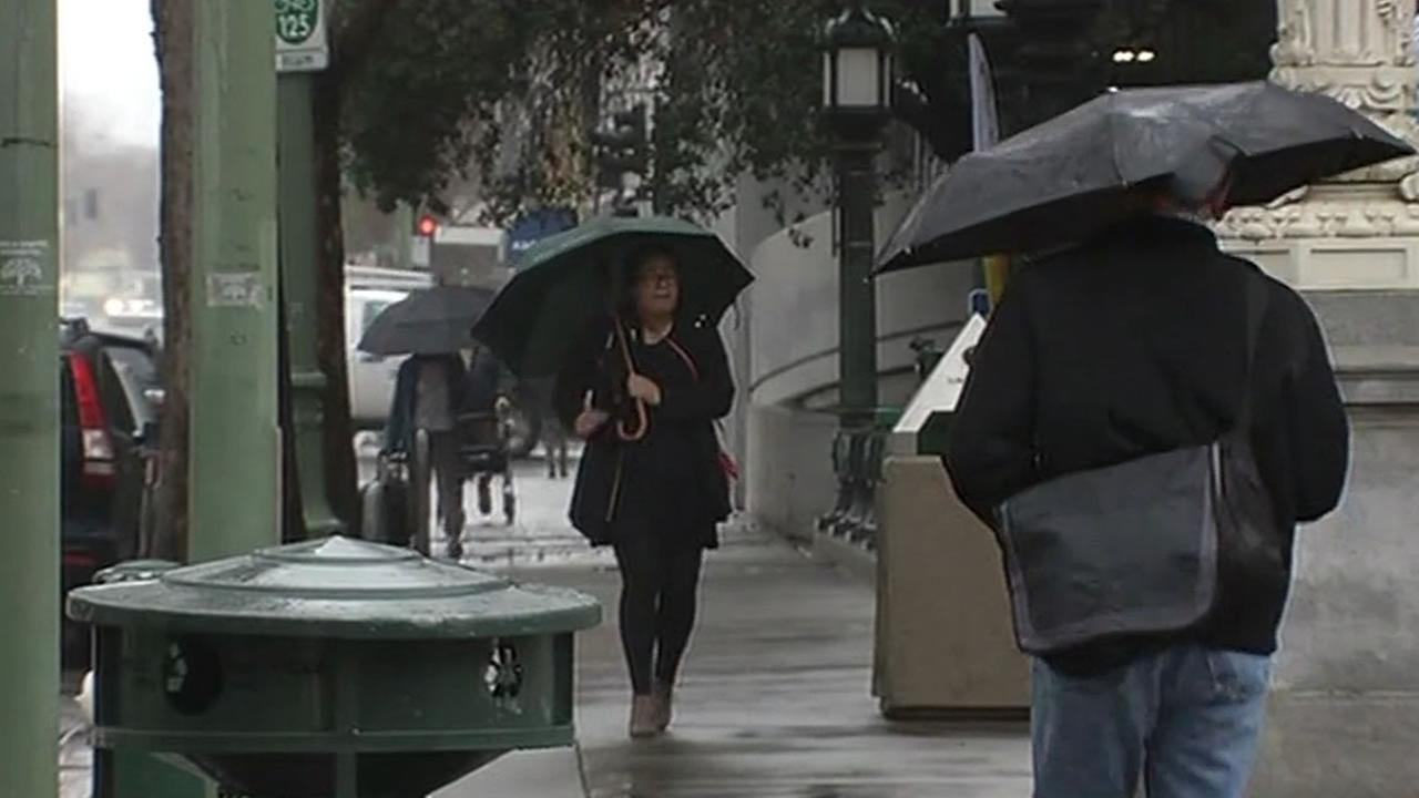people walk in the Bay Area with umbrellas