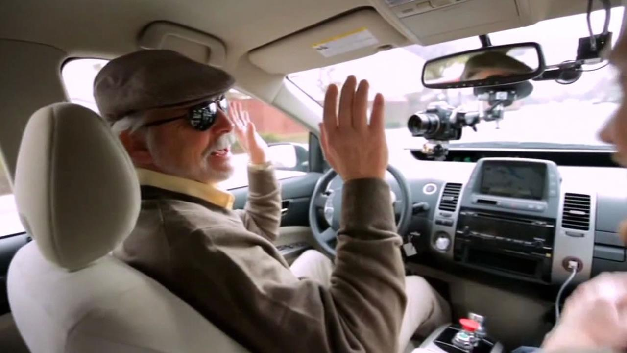 Steve Mahan is seen taking a spin in one of Googles driverless cars in this undated image.