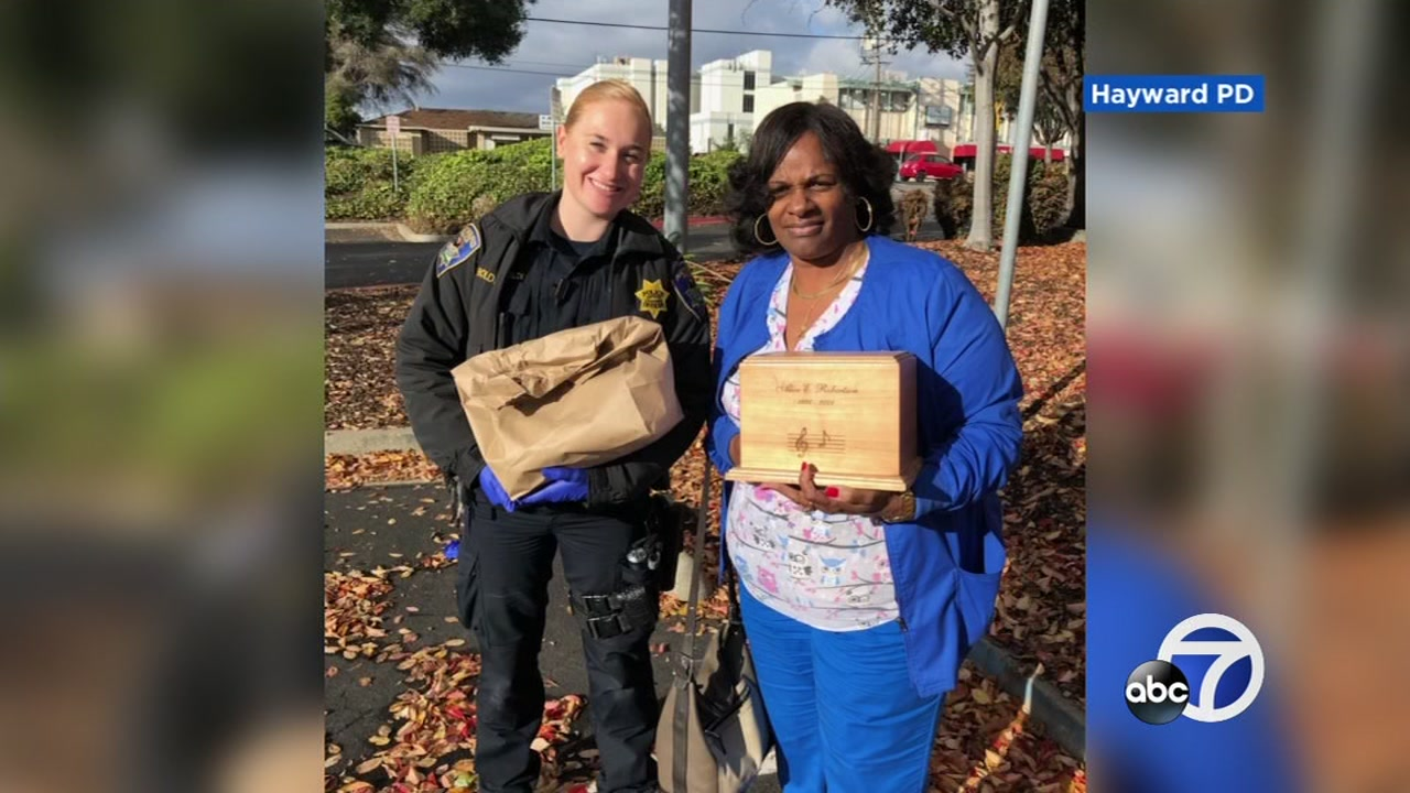 This image shows an officer returning stolen ashes to a San Leandro, Calif. woman on Saturday, Dec. 01, 2018.