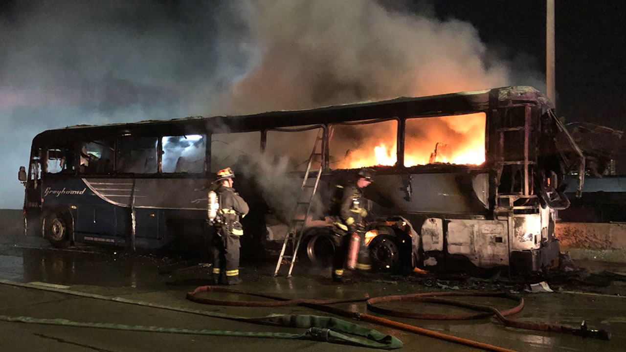This photo shows a Greyhound bus on fire in Oakland, Calif. on Saturday, Dec. 01, 2018.