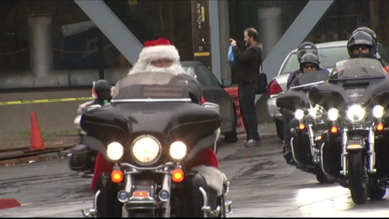 Santa Claus is seen riding a Harley Davidson motorcycle in this undated image.