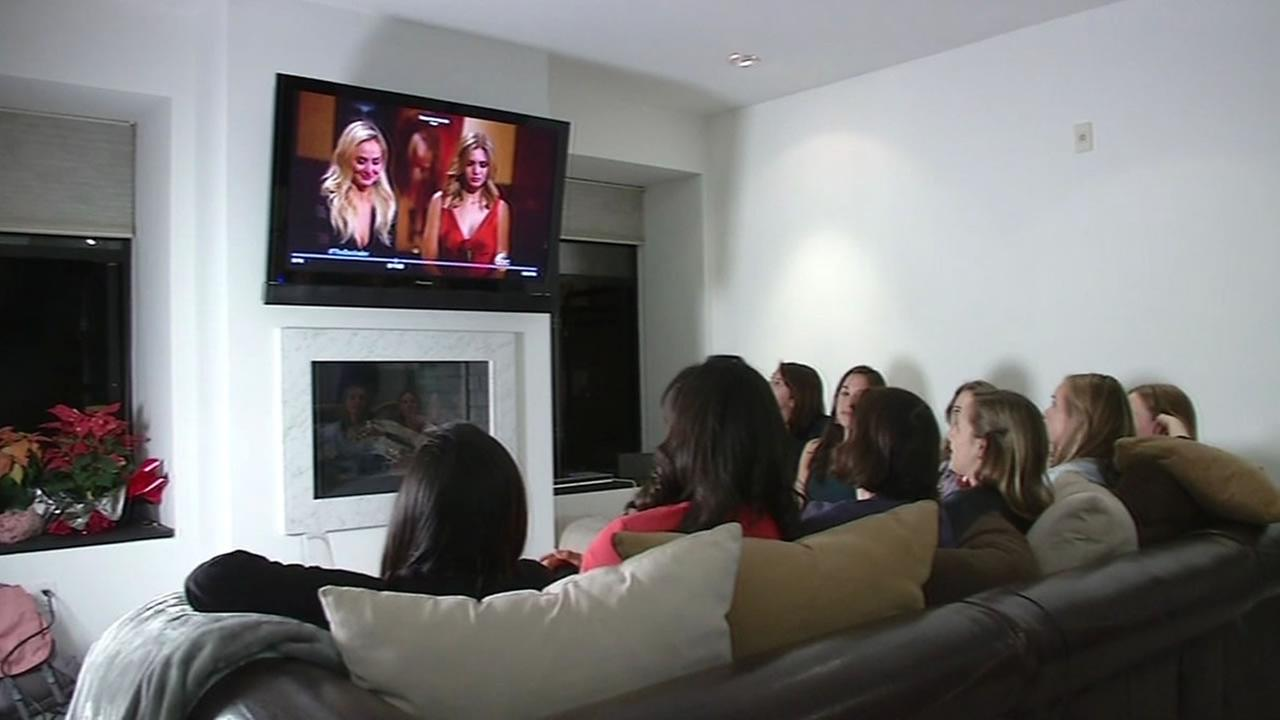 group of women bet on The Bachelor