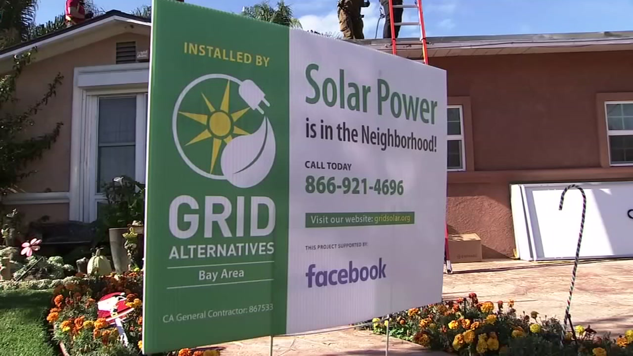 A sign for GRID Alternatives is seen outside a home receiving a solar system in this undated image.