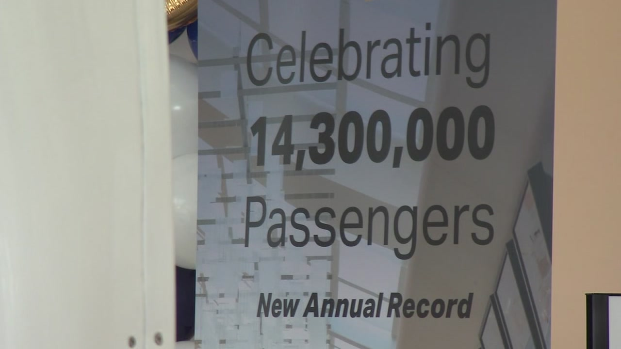 A sign celebrating a record number of travelers is seen at the San Jose International Airport in San Jose, Calif. on Wednesday, Dec. 19, 2018.