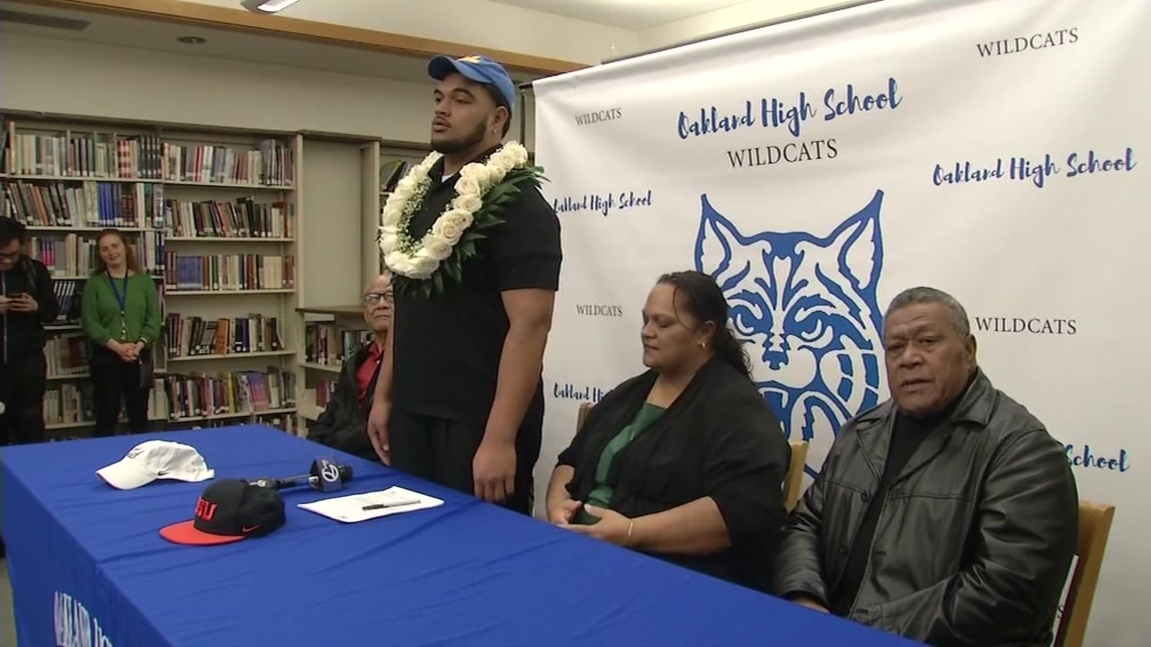 This image shows Siale Liku on National Signing Day, Wednesday, Dec. 20, 2018 at Oakland High School in Oakland, Calif.