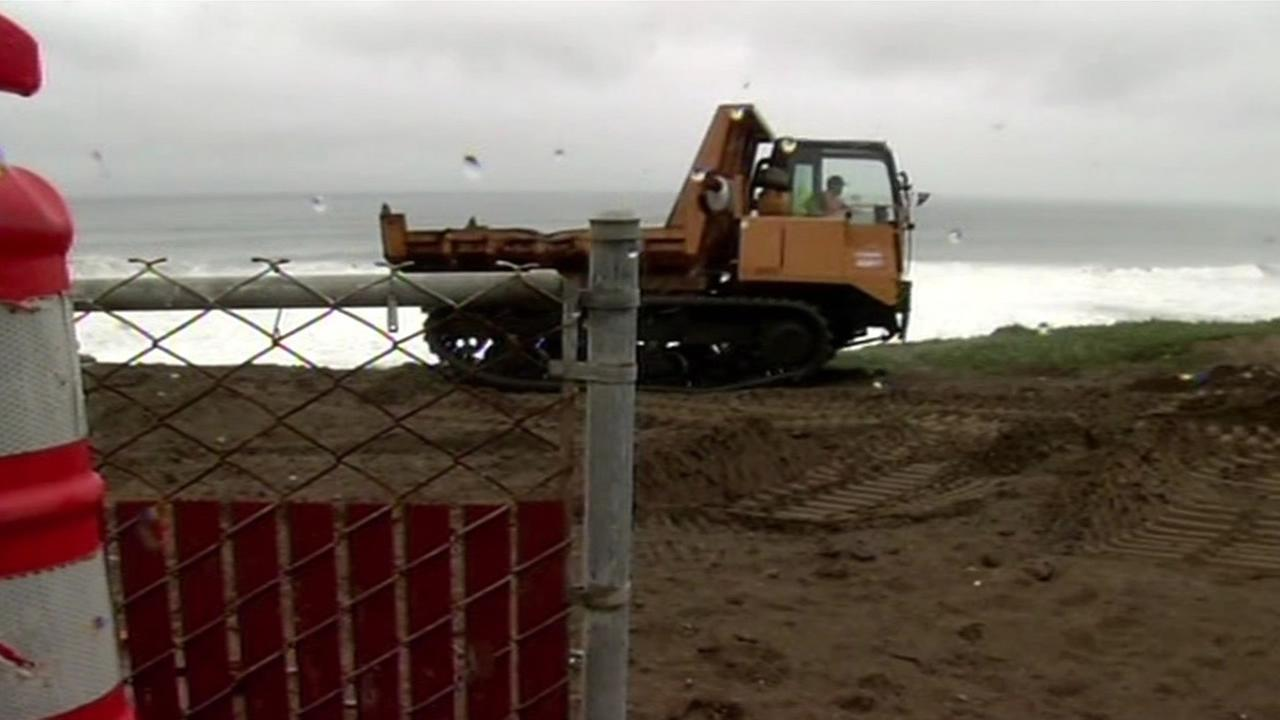 Construction crews are fighting erosion by shoring up Pacificas waterfront with dirt and rock on Friday, March 4, 2016.