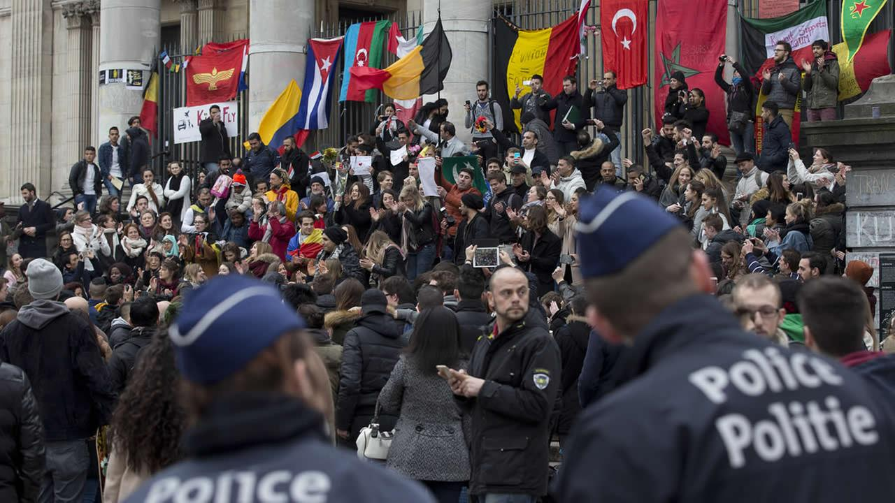 Belgian police patrols as people gathered to mourn for the victims of the bombings at the Place de la Bourse in the center of Brussels, Belgium, Thursday, March 24, 2016.
