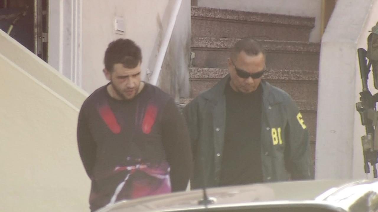 Stanislav Petrov is seen with an FBI agent in this image on Friday, April 1, 2016.