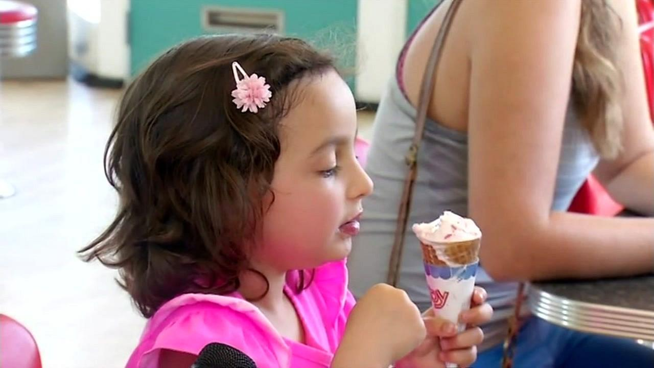A girl is seen eating ice cream during a one-day heat wave in the South Bay on Wednesday, April 6, 2016.